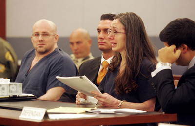 CRAIG MORAN/REVIEW-JOURNAL News--Left, Craig Titus listens to his wife Kelly Ryan (center) while she reads a statement  during the penality phase in Clark County Distric Court on Friday, Aug. 22,2008. In May, Titus and Ryan pleaded guilty to various charges in connection with the slaying of their personal assistant Melissa Ja mes, whose charred body was found in a torched Jaguar in the desert in 2005