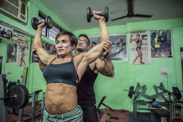 *** EXCLUSIVE - VIDEO AVAILABLE ***    NEW DELHI, INDIA - SEPTEMBER 22: Borun (L) and Mamota Yumnan are seen training together in their gym on September 22, 2017 in New Delhi, India.    MEET the first Indian couple to win medals in international bodybuilding championships. Married couple, Borun and Mamota Devi Yumnam from New Delhi are dedicating their lives to becoming India?s top bodybuilding couple. And with over 28 awards between them, they?re taking the sport by storm. Borun, 39, has been competing for over 20 years, whilst his wife began her bodybuilding career in 2012 - after having three children.     PHOTOGRAPH BY Shams Qari / Barcroft Images