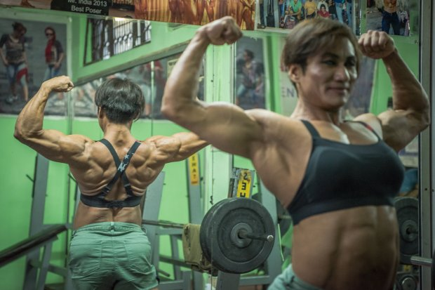 *** EXCLUSIVE - VIDEO AVAILABLE ***    NEW DELHI, INDIA - SEPTEMBER 22: Mamota Yumnan is seen posing for a photo in her gym on September 22, 2017 in New Delhi, India.    MEET the first Indian couple to win medals in international bodybuilding championships. Married couple, Borun and Mamota Devi Yumnam from New Delhi are dedicating their lives to becoming India?s top bodybuilding couple. And with over 28 awards between them, they?re taking the sport by storm. Borun, 39, has been competing for over 20 years, whilst his wife began her bodybuilding career in 2012 - after having three children.     PHOTOGRAPH BY Shams Qari / Barcroft Images