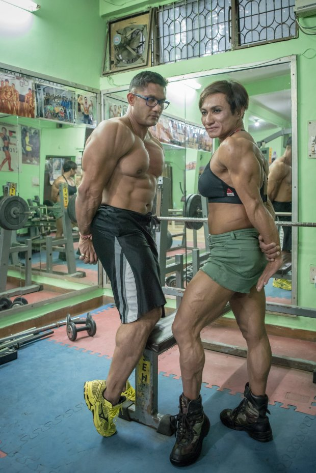 *** EXCLUSIVE - VIDEO AVAILABLE ***    NEW DELHI, INDIA - SEPTEMBER 22: Borun (Left) and Mamota Yumnan pose for a picture while showing off their muscular bodies on September 22, 2017 in New Delhi, India.    MEET the first Indian couple to win medals in international bodybuilding championships. Married couple, Borun and Mamota Devi Yumnam from New Delhi are dedicating their lives to becoming India?s top bodybuilding couple. And with over 28 awards between them, they?re taking the sport by storm. Borun, 39, has been competing for over 20 years, whilst his wife began her bodybuilding career in 2012 - after having three children.     PHOTOGRAPH BY Shams Qari / Barcroft Images